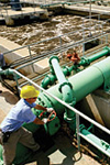 Engineers oversee aeration tanks at wastewater treatment plant