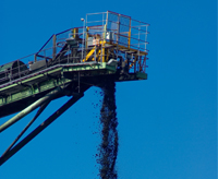 Mined coal on industrial conveyor belt equipment