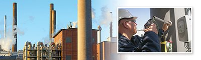 Brick factory with large stacks/flues; FCI engineer installing meter in large stack